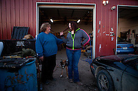 "Shelia Burnett, left, and her daughter Lauren Burnett joke around in front of Boggs Auto Salvage and Sales in Franklin, Mo. ""I don't know why I'm going through this other than making my daughter a stronger person,"" Burnett said."