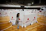 "Fukushima city, April 27 2011 - (eng) In the main shelter of Fukushima city. More than 2 months after the earthquake, 700 people are still refugees in this shelter. Slogans on the cardboards : ""Try your best, Japan""...(fr) Dans le gymnase de Fukushima, ou 700 personnes sont encore refugies pres de deux mois apres le seisme. Les cartons portent les couleurs du Japon et le slogan ""Courage, le Japon""."