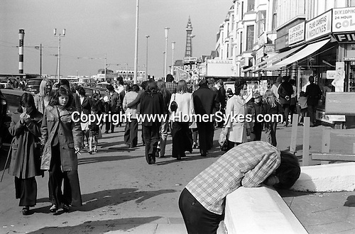 Blackpool the Golden Mile. Lancashire England. 1974 Youn man head in hands.