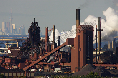August 21, 2004. Hamilton, Ontario. The view looking north from the escarpment of Hamilton's Stelco Steel blast furnace with Toronto visible across Lake Ontario in the background. Other landmarks the Skyway bridge...Photo: Ron Scheffler