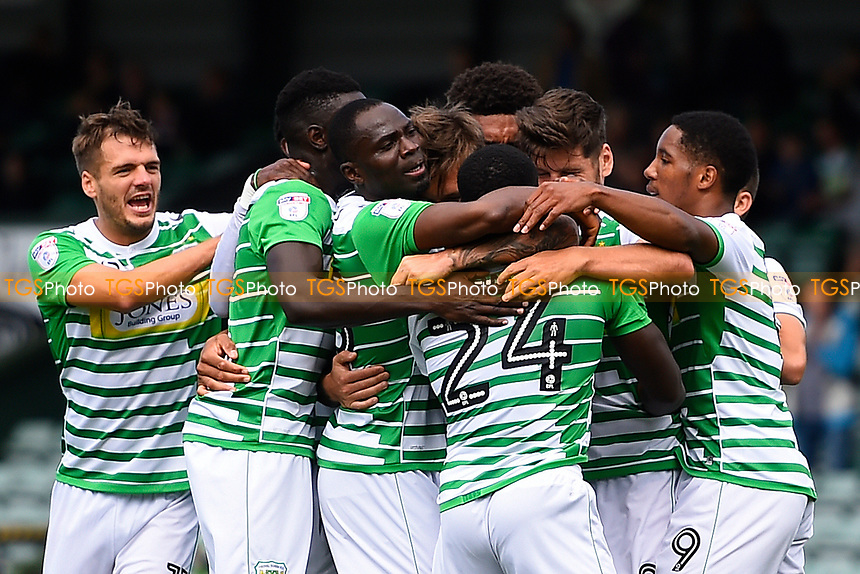 Yeovil Town players mob Olufela Olomola of Yeovil Town (24) after scoring the first goal during Yeovil Town vs Accrington Stanley, Sky Bet EFL League 2 Football at Huish Park on 12th August 2017