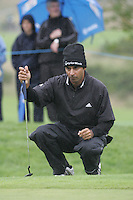 Jyoti Randhawa lines up his putt on the 5th green during the first round of the Smurfit Kappa European Open at The K Club, Strffan,Co.Kildare, Ireland 5th July 2007 (Photo by Eoin Clarke/NEWSFILE)
