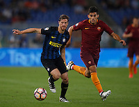 Calcio, Serie A: Roma vs Inter. Roma, stadio Olimpico, 2 ottobre 2016.<br /> FC Inter's Cristian Ansaldi, left, is chased by Diego Perotti during the Italian Serie A football match between Roma and FC Inter at Rome's Olympic stadium, 2 October 2016.<br /> UPDATE IMAGES PRESS/Isabella Bonotto