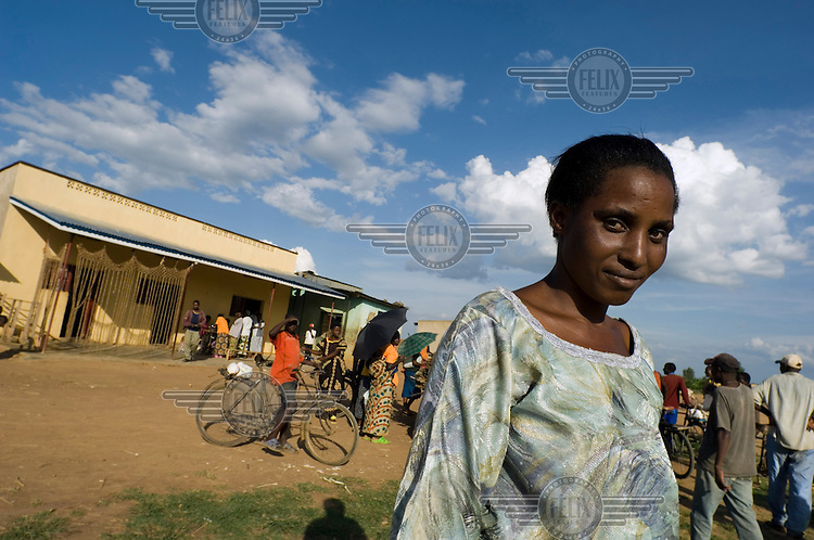 Jacqueline Nyiramayonde outside her shop in Nyamata. Nyamata was singled out to be part of The Earth Institute's Millennium Villages Project, a project that aims to use a 'grass roots' approach to lifting developing country villages out of poverty. On her return to her ancestral village of Nyamata in 1998, Jacqueline adopted five members of her extended family who had been orphaned by the 1994 genocide.