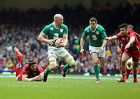 Pictured: Paul O'Connell of Ireland (2nd L) is tripped up by Luke Charteris of Wales (L) Saturday 14 March 2015<br />