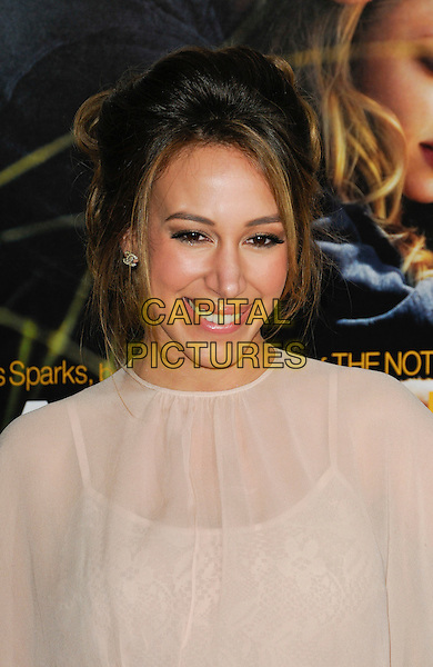 "HAYLIE DUFF .Arriving at the world premiere of ""Dear John"" at Grauman's Chinese Theatre in Hollywood, California, USA, .February 1st 2010.  .arrivals portrait headshot smiling hair up earrings cc chanel logo studs sheer see thru through beige  cream nude.CAP/ROT.©Lee Roth/Capital Pictures"