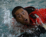 10/22/02--Al Diaz Photo--Boot camp at The United States Coast Guard Training Center Cape May, NJ.  .Swimming laps at the base training  pool David Hong,22, wearing a cold weather imersion suit. ..