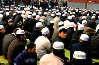 CHINA. Beijing. Worshipers at Niu Jie Mosque during the festival of Eid-al-Fitr, marking the end of Ramadan. 2005
