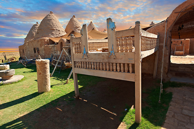 """Pictures of the beehive adobe buildings of Harran with a summer outdoor bed,  south west Anatolia, Turkey.  Harran was a major ancient city in Upper Mesopotamia whose site is near the modern village of Altınbaşak, Turkey, 24 miles (44 kilometers) southeast of Şanlıurfa. The location is in a district of Şanlıurfa Province that is also named """"Harran"""". Harran is famous for its traditional 'beehive' adobe houses, constructed entirely without wood. The design of these makes them cool inside. 31"""