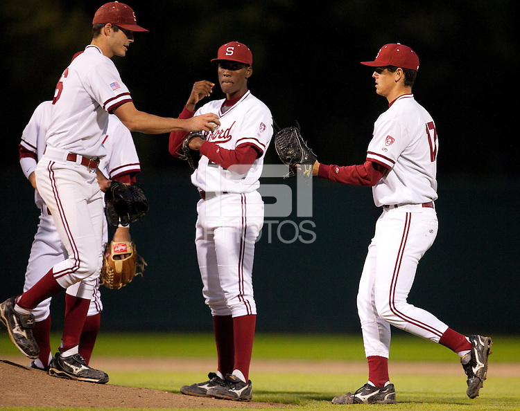 STANFORD, CA - March 25, 2011: Mark Appel of Stanford baseball hands the game ball to A.J. Vanegas for relief during Stanford's game against Long Beach State at Sunken Diamond. Stanford lost 6-3.