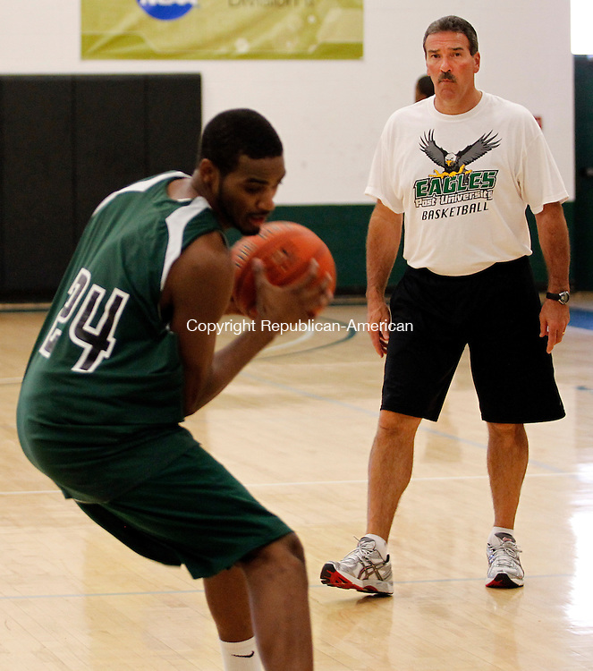 Waterbury, CT- 28, October 2010-102810CM05 Al Sokaitis  runs through a mock play during practice at the Drubner Athletic Center at Post University in Waterbury. Sokaitis will be the new head coach for the men's basketball team. Christopher Massa Republican-American