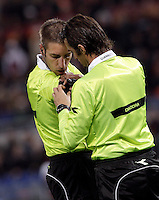 Calcio, Serie A: Roma vs Udinese. Roma, stadio Olimpico, 28 ottobre 2012..Referee Davide Massa is helped by Added referee Antonio Giannoccaro is helped by Added referee Antonio Giannoccaro, right, to adjust his microphone during the Italian Serie A football match between AS Roma and Udinese, at Rome, Olympic stadium, 28 October 2012..UPDATE IMAGES PRESS/Riccardo De Luca