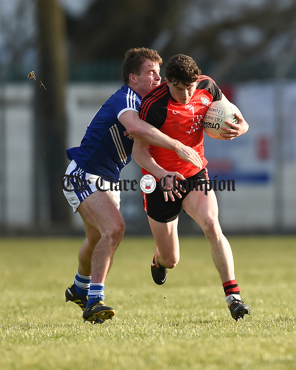Sean Collins of Cratloe in action against Ryan Jennings of Clondegad during their Cusack Cup game in Ballynacally. Photograph by John Kelly.