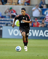 AC Milan midfielder Ronaldinho (80) dribbles down the field.  AC Milan defeated the Chicago Fire 1-0 at Toyota Park in Bridgeview, IL on May 30, 2010.