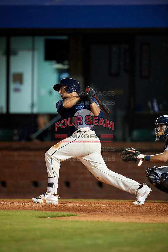 Mobile BayBears designated hitter Jose Briceno (35) follows through on a swing during a game against the Pensacola Blue Wahoos on April 25, 2017 at Hank Aaron Stadium in Mobile, Alabama.  Mobile defeated Pensacola 3-0.  (Mike Janes/Four Seam Images)