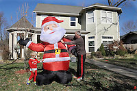 NWA Media/ J.T. Wampler -Scott Walker and his son Grayson, 4, put up an inflatable Santa Friday Nov. 28, 2014 at their Bentonville home. The yard decorations are an annual Walker family tradition with the Santa and an inflatable Razorback going up the day after Thanksgiving.