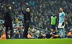 Nicolas Otamendi of Manchester City and Manchester City Manager Josep Guardiola look at Tottenham Hotspur Manager Mauricio Pochettino after the challenge on Harry Kane of Tottenham Hotspur during the premier league match at the Etihad Stadium, Manchester. Picture date 16th December 2017. Picture credit should read: Robin ParkerSportimage