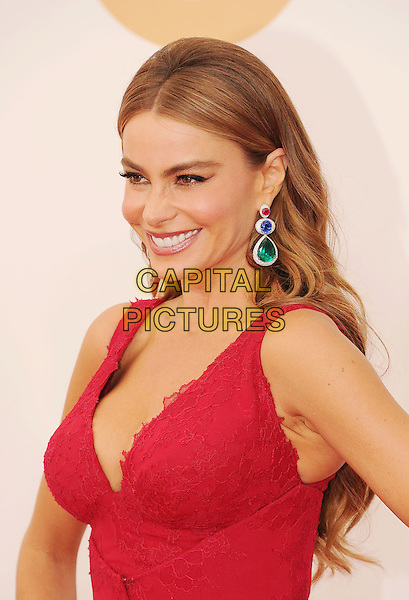 Sofia Vergara<br /> The 65th Annual Primetime Emmy Awards - Arrivals held at The Nokia Theatre L.A. Live in Los Angeles, California, USA.<br /> September 22nd, 2013<br /> headshot portrait dangling earrings green blue diamonds red lace cleavage viagra eyebrows <br /> CAP/ROT/TM<br /> &copy;Tony Michaels/Roth Stock/Capital Pictures