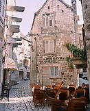 CROATIA, Hvar, Dalmatian Coast, people relaxing at outdoors cafe