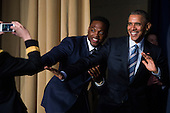 United States President Barack Obama strikes the Heisman Trophy pose with Heisman Trophy winner Derrick Henry at the conclusion of the National Prayer Breakfast in Washington, DC, USA, 03 February 2016. For 63 years the National Prayer Breakfast has given presidents the  opportunity to gather with members of congress and evangelical Christians to pray and talk about the role of prayer in their own lives.<br /> Credit: Shawn Thew / Pool via CNP