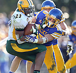 BROOKINGS, SD - SEPTEMBER 28:  John Crockett #23 from North Dakota State University tries to spin away from Andrew Brown #15 from South Dakota State University in the fourth quarter of their game Saturday afternoon at Coughlin Alumni Stadium in Brookings. (Photo by Dave Eggen/Inertia)