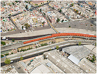 Aerial shot of Mexico City's metro or subway snakes through the urban sprawl.
