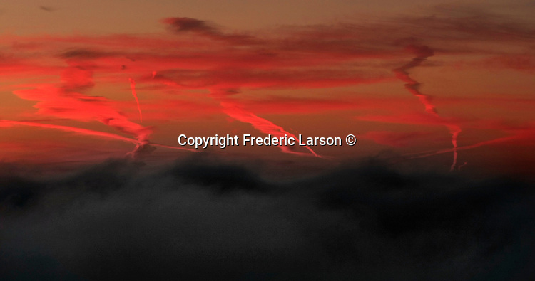 Red skies at dawn seen over the San Francisco from the Marin Headlands in Sausalito, California.