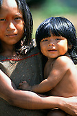 Bacaja village, Amazon, Brazil. Girl holding a smiling baby; Xicrin tribe.
