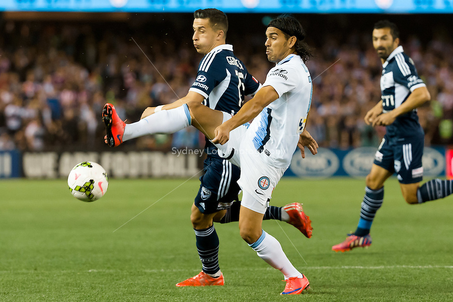 David Williams of City and Daniel Georgievski of the Victory compete for the ball in the semi final match between Melbourne Victory and Melbourne City in the Australian Hyundai A-League 2015 season at Etihad Stadium, Melbourne, Australia.<br /> This photo is not for sale. Contact zumapress.com for editorial licensing.