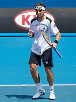 DAVID FERRER (ESP) against JUAN IGNACIO CHELA (27) (ARG)  in the third round of the Men's Singles. David Ferrer beat Juan Ignacio Chela 7-5 6-2 6-1..21/01/2012, 21st January 2012, 21.01.2012..The Australian Open, Melbourne Park, Melbourne,Victoria, Australia.@AMN IMAGES, Frey, Advantage Media Network, 30, Cleveland Street, London, W1T 4JD .Tel - +44 208 947 0100..email - mfrey@advantagemedianet.com..www.amnimages.photoshelter.com.
