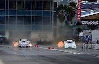 Mar. 11, 2012; Gainesville, FL, USA; NHRA funny car driver Jack Beckman (right) races alongside Bob Bode during the Gatornationals at Auto Plus Raceway at Gainesville. Mandatory Credit: Mark J. Rebilas-