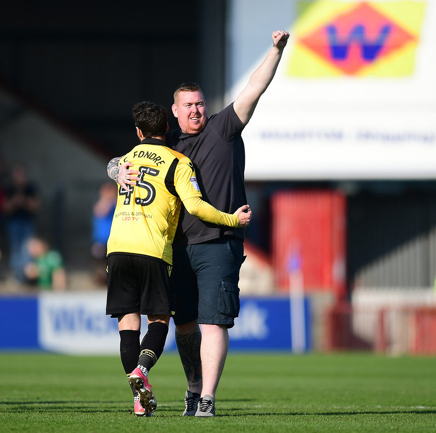 A spectator, who had ran on the pitch, hugs Bolton Wanderers&rsquo; Adam Le Fondre at the end of the game<br /> <br /> Photographer Chris Vaughan/CameraSport<br /> <br /> The EFL Sky Bet League One - Scunthorpe United v Bolton Wanderers - Saturday 8th April 2017 - Glanford Park - Scunthorpe<br /> <br /> World Copyright &copy; 2017 CameraSport. All rights reserved. 43 Linden Ave. Countesthorpe. Leicester. England. LE8 5PG - Tel: +44 (0) 116 277 4147 - admin@camerasport.com - www.camerasport.com
