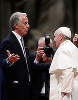 Papa Francesco saluta il presidente del CONI Giovanni Malago' alla messa per gli sportivi in occasione del 100esimo anniversario del CONI, nella Basilica di San Pietro, Citta' del Vaticano, 19 dicembre 2014.<br /> Pope Francis greets Italian Olympic Committee (CONI) president Giovanni Malago', on the occasion of a mass for CONI's 100th anniversary in St. Peter's Basilica at the Vatican, 19 December 2014.<br /> UPDATE IMAGES PRESS/Isabella Bonotto<br /> <br /> STRICTLY ONLY FOR EDITORIAL USE