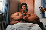 Walter Hudson, who becaume famous as a recluse who had reached the weight of an estimated 1100 pounds, seen exercising in the one room he isolates himself in in his sister's home in Hempstead, NY. Photo by Jim Peppler. Copyright Jim Peppler/1988. .