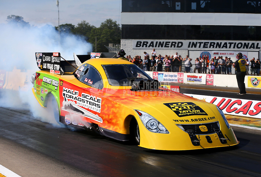 Aug. 17, 2013; Brainerd, MN, USA: NHRA funny car driver Bob Bode during qualifying for the Lucas Oil Nationals at Brainerd International Raceway. Mandatory Credit: Mark J. Rebilas-