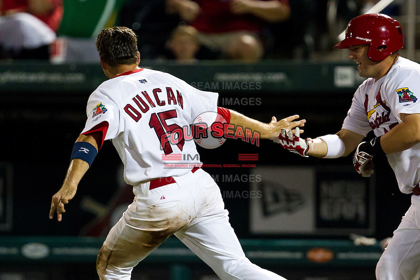 Eric Duncan (15) of the Springfield Cardinals celebrates with Matt Adams (25) after scoring the winning run during a game against the Midland RockHounds at Hammons Field on July 11, 2011 in Springfield, Missouri. (David Welker / Four Seam Images)
