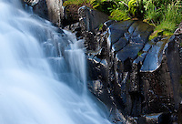 Here is a horizontal version of one of the waterfalls in Yankee Boy Basin. I initally noticed the shiny rocks reflecting the green mosses and the blue sky.<br /> <br /> Canon EOS 5D, 70-200mm f/2.8L lens