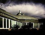 A glass conservatory prepares to weather a winter storm.