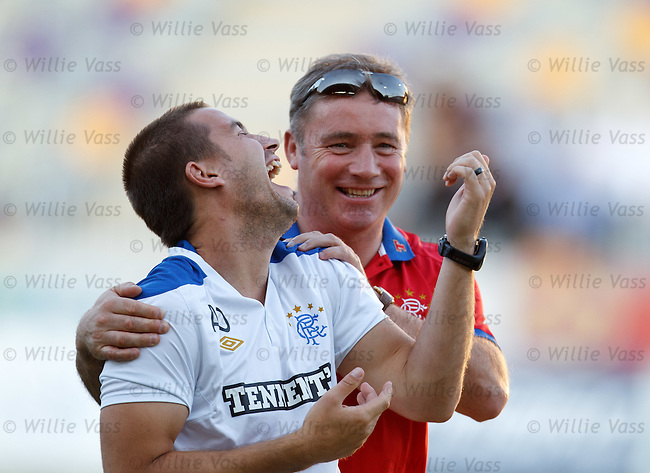 ALly McCoist laughing with fitness coach Adam Owen who cracks up at one of the gaffers jokes