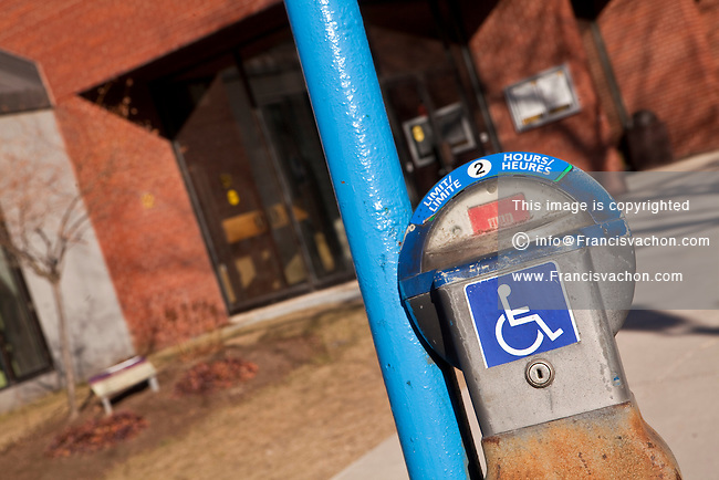 A parking meter reserved for handicapped is pictured in Fredericton, New Brunswick Tuesday April 3, 2012.