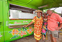 Two Tahitian women with Caucasian tourist  at Le Truck lunch truck