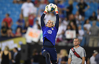 CHARLOTTE, NC - OCTOBER 03: Ashlyn Harris #18 of the United States leaps high for a ball in warm ups prior to their game versus Korea Republic at Bank of American Stadium, on October 03, 2019 in Charlotte, NC.