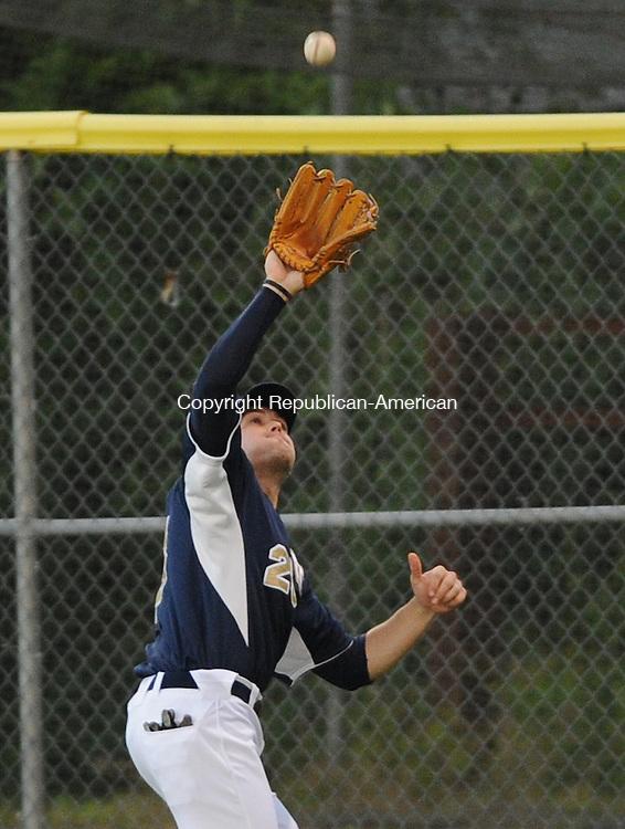 TORRINGTON, CT-07 JUNE 2012--0607012JS03--Torrington's Gus Craig (25) runs down a fly-ball during their game against the Wachusett Dirt Dawgs Thursday at Fuessenich Park in Torrington. .Jim Shannon Republican-American