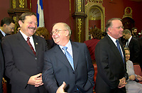 FILE PHOTO March 8 2001 Quebec, Canada<br /> <br /> Ministers jacques Brassard (L) and  Guy Chevrette (M)  chat before the presentation of Bernard Landry (L) new cabinet, March 8 2001, at the National Assembly, in Quebec City.