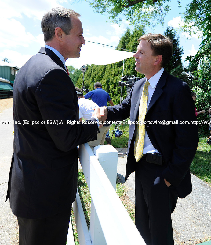 Maryland Governor Martin O'Malley greets Kentucky Derby winning trainer Graham Motion at the Stake Barn before the Preakness Stakeson Preakness Day at Pimlico Race Course in Baltimore, Maryland on May 21, 2011