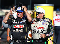 Jul. 26, 2013; Sonoma, CA, USA: NHRA funny car driver John Force (right) with track specialist Lanny Miglizzi during qualifying for the Sonoma Nationals at Sonoma Raceway. Mandatory Credit: Mark J. Rebilas-