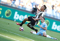 Calcio, Serie A: Lazio vs Juventus. Roma, stadio Olimpico, 27 agosto 2016.<br /> Juventus&rsquo; Paulo Dybala, left, is tackled by Lazio&rsquo;s Stefan Radu, during the Serie A soccer match between Lazio and Juventus, at Rome's Olympic stadium, 27 August 2016. Juventus won 1-0.<br /> UPDATE IMAGES PRESS/Isabella Bonotto