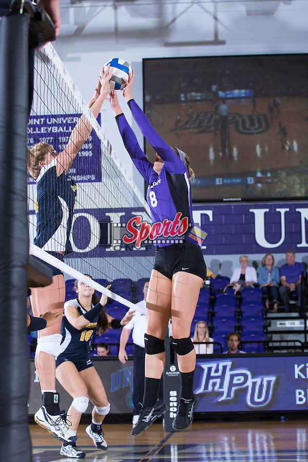 Gabi Mirand (8) of the High Point Panthers battles for the ball at the net during the match against the UNC Greensboro Spartans at Millis Athletic Center on September 16, 2014 in High Point, North Carolina.  The Panthers defeated the Spartans 3-0.   (Brian Westerholt/Sports On Film)