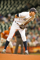 Rice Owls starting pitcher Austin Kubitza #21 looks to his catcher for the sign against the Texas Longhorns at Minute Maid Park on March 2, 2012 in Houston, Texas.  The Longhorns defeated the Owls 11-8.  (Brian Westerholt/Four Seam Images)