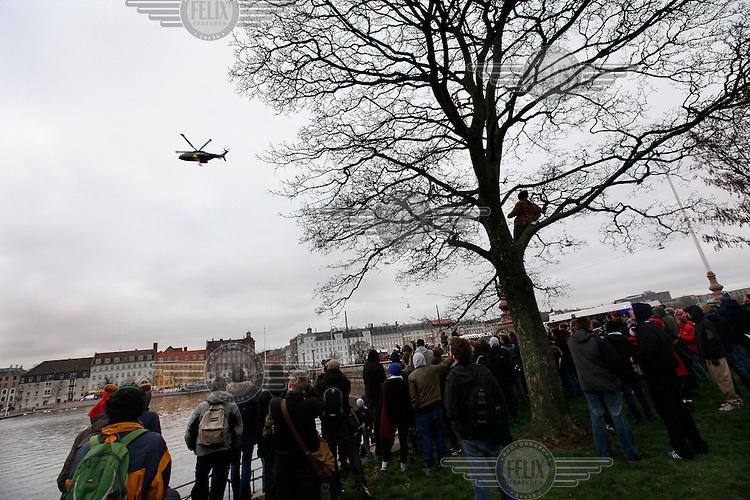Military helicopter makes a low pass over a demonstration in the center of Copenhagen. United Nations Climate Change Conference (COP15) was held at Bella Center in Copenhagen from the 7th to the 18th of December, 2009. A great deal of groups tried to voice their opinion and promote their cause in various ways. The conference and demonstrations was covered by thousands of photographers and journalists from all over the world...©Fredrik Naumann/Felix Features.